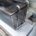 frying basket covered with carbon