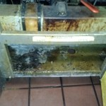 Inside of fryer is covered in carbon