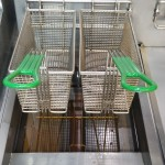 Clean oil with clean baskets hanging on a clean fryer